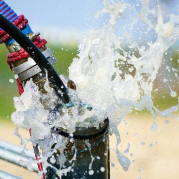 Cleaning newly constructed water bore or well with air compressor
