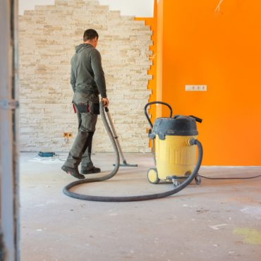 Construction worker Vacuuming Dust