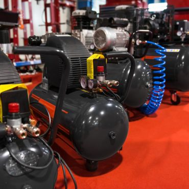Many Air compressors pressure pumps closeup photo
